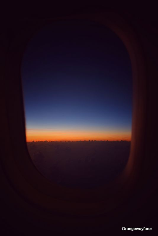 Sunrise as seen from flight window