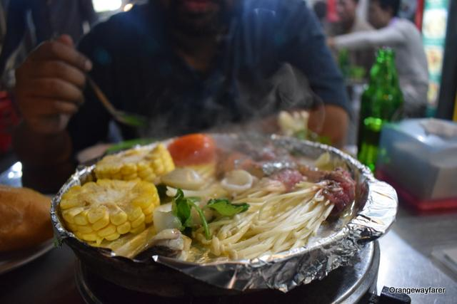 Wait till the steam comes up! Final step! Hot Plate at Hanoi Street Food