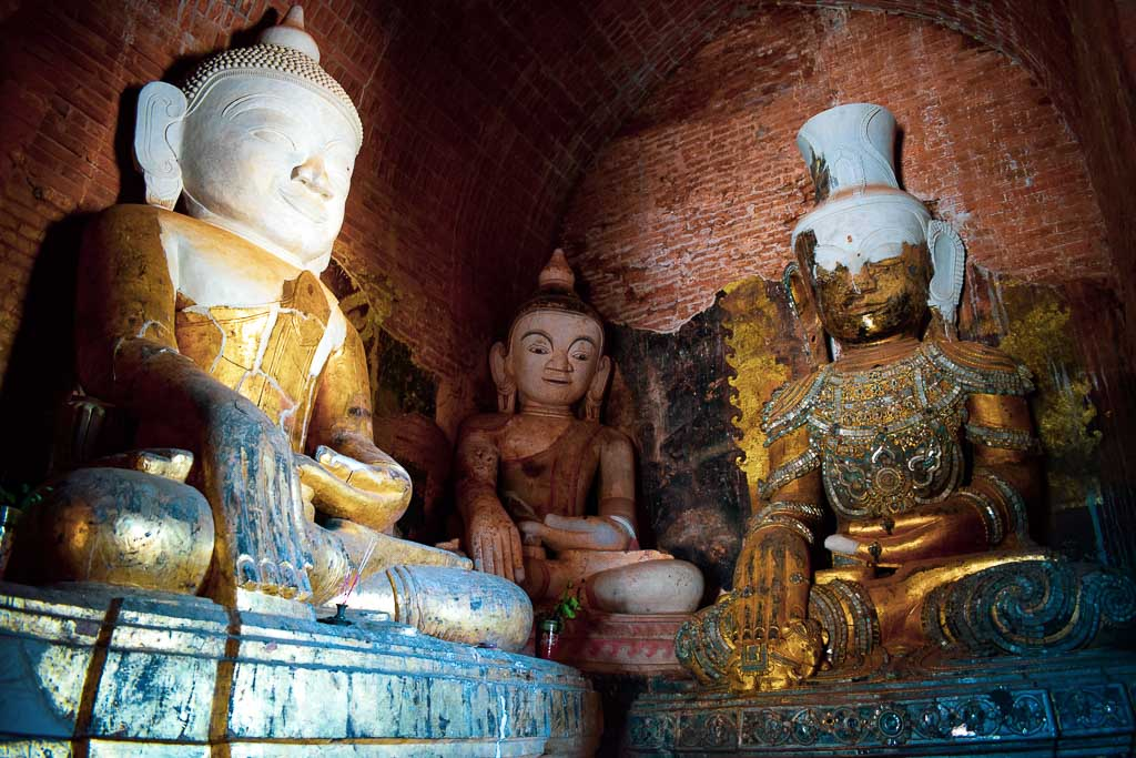 inside the temples of old Bagan: Murals and old Buddha statue