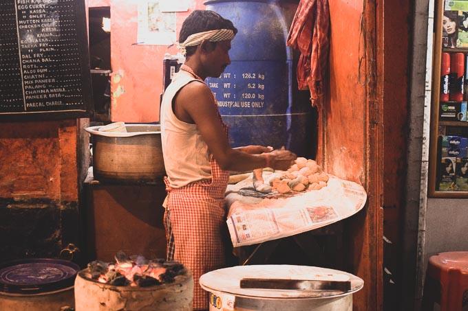 A man makes Ruti, Indian bread at Decker's Lane