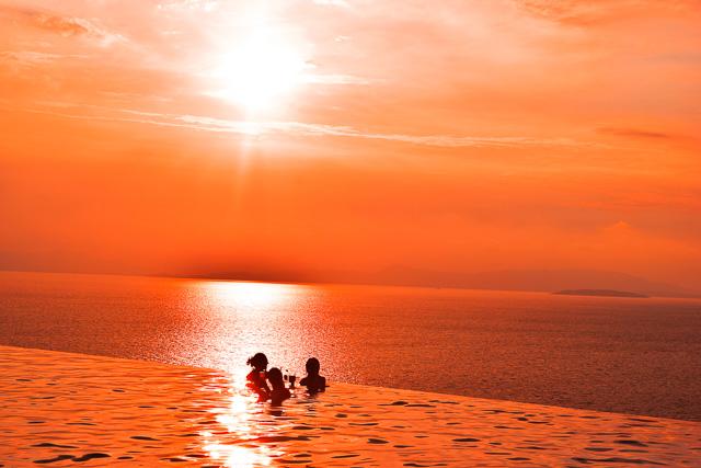 Sunset in Thailand. Infinity pool at Santhia Resort Koh Yai Noi