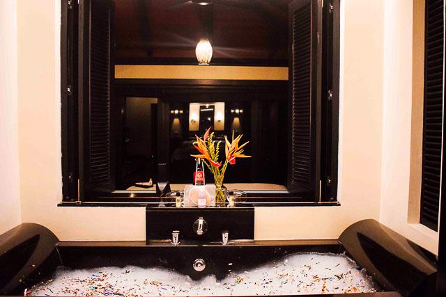 Bedroom with attached bathtub at taj madikeri resort & spa, coorg madikeri, karnataka