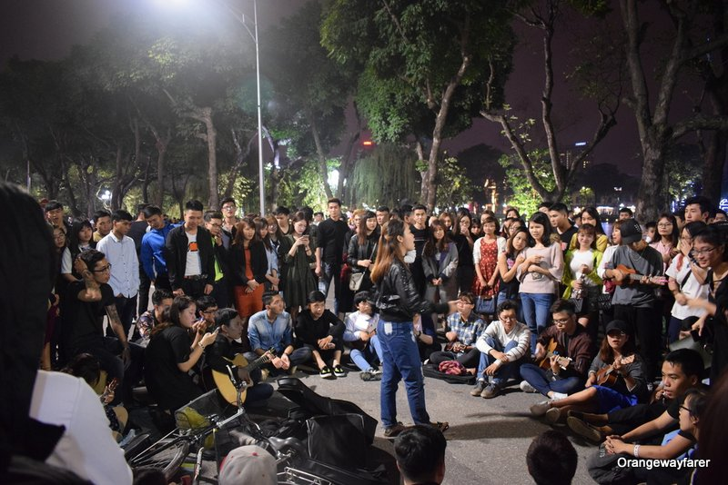 Young people performing at the streets of Hanoi on a weekend night!