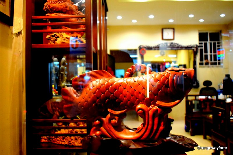 A wooden fish spotted at one of the old shops at the alleys of Hanoi Old Quarter