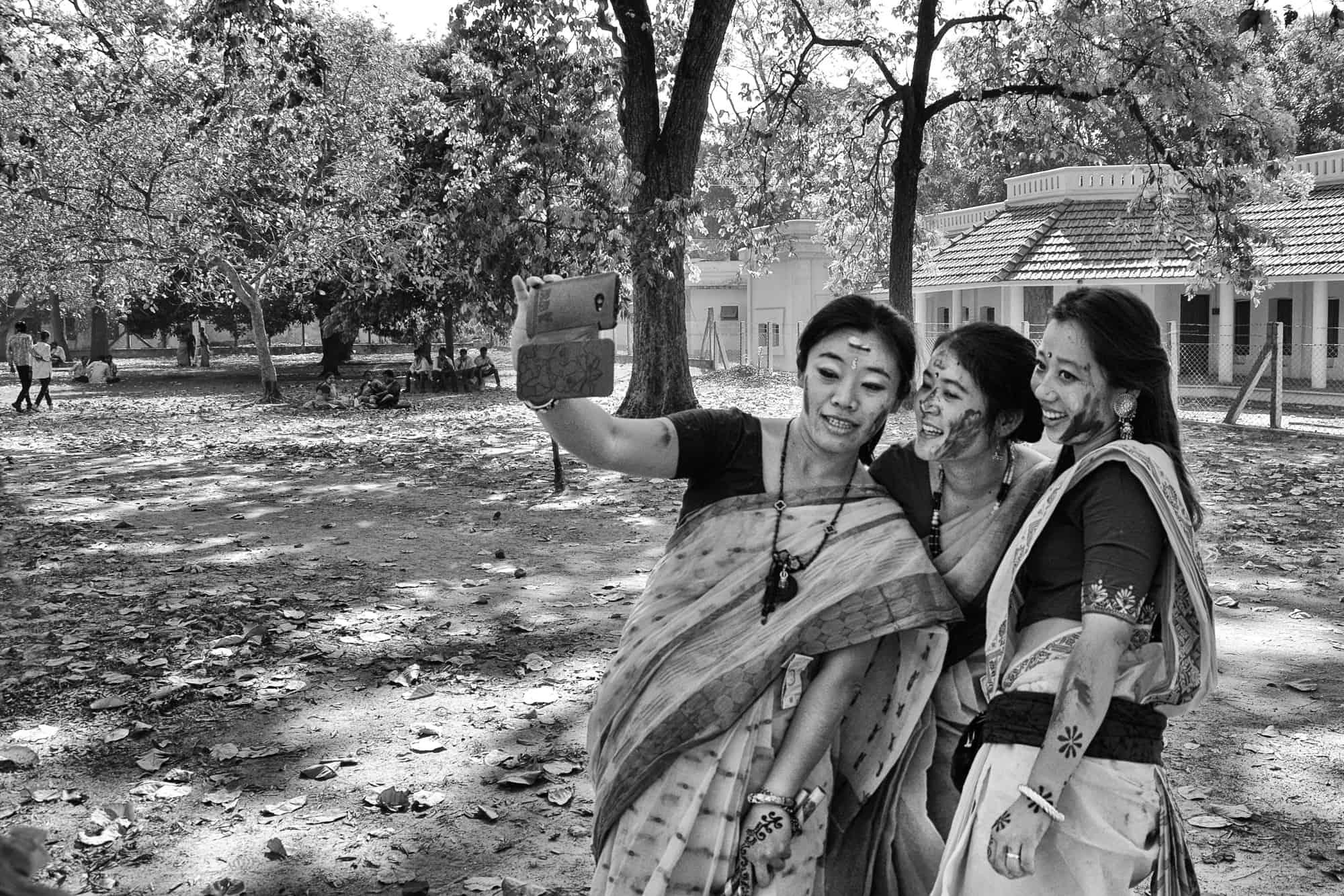 A group of women taking selfie in Shantiniketan