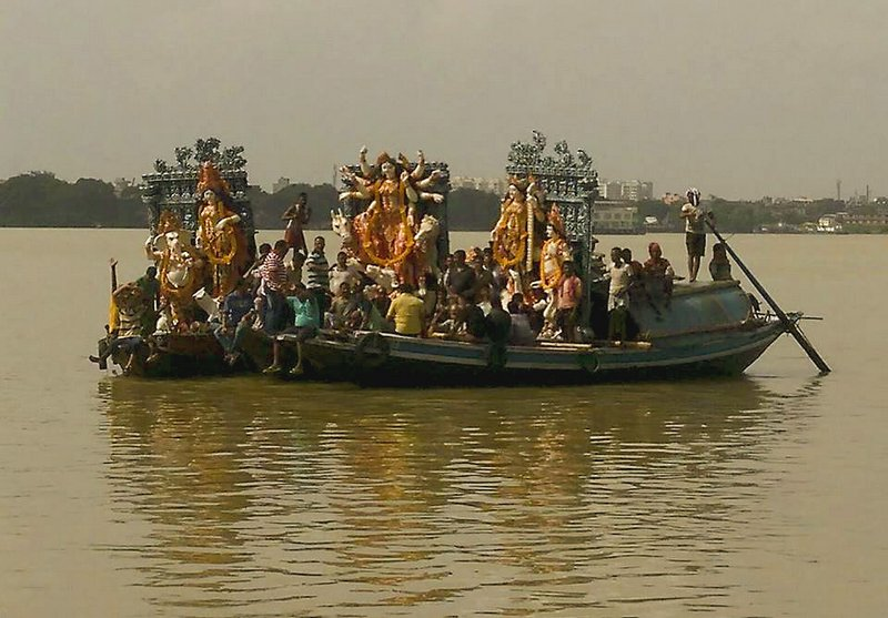 Durga thakur on Ganga by boat