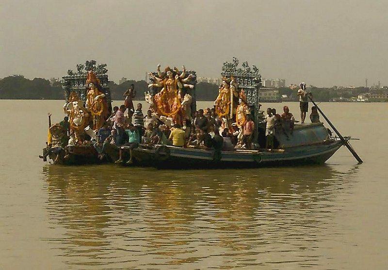 Durga thakur on Ganga by boat