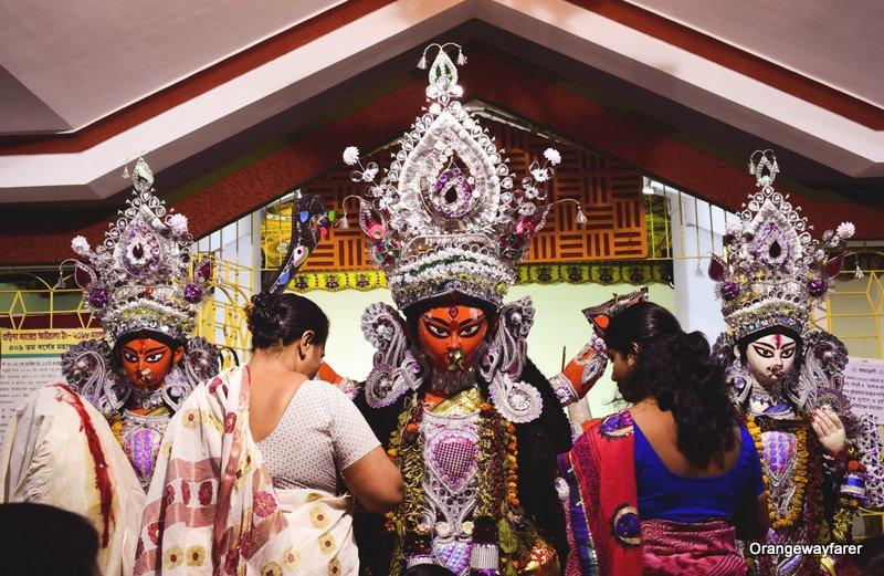 Bijaya. Durga puja in Kolkata. SIndurkhela at bonedi barir durga puja.