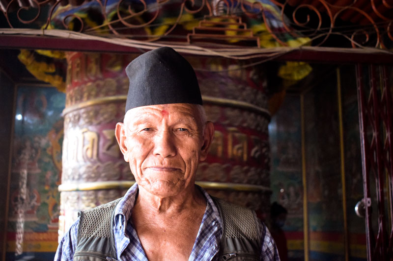 Nepali Man portrait Shot Buddhist Prayer wheel