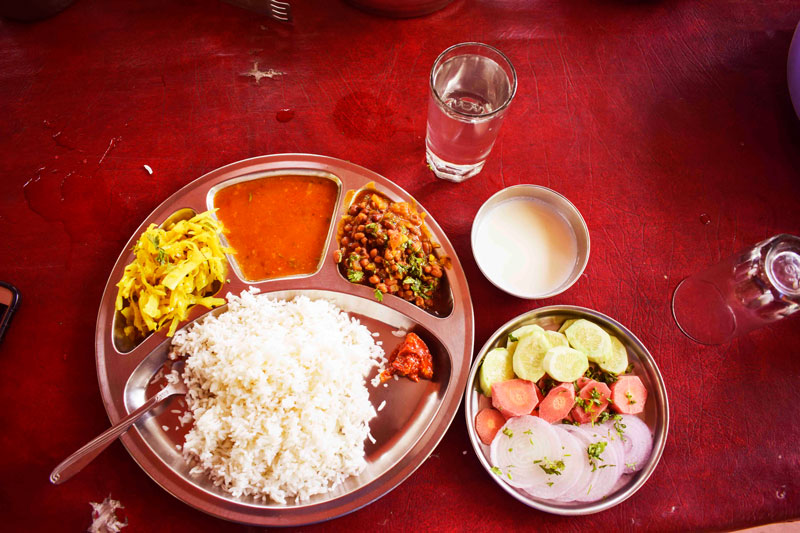 Eating a vegeterian thali at Dandeli. The meal was filling and delightful.
