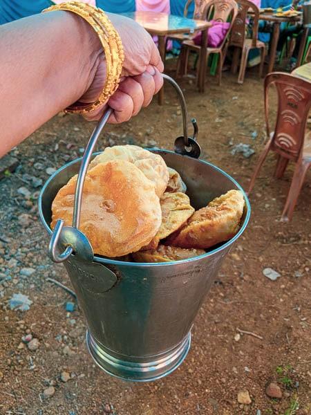 A bucket fiull of Kochuri: breakfast for Bengali wedding day