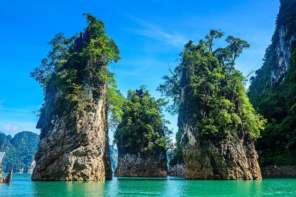 Cheow Lan Lake with three monolith rising above Andaman Sea. Khao Sak National Park. One of the most beautiful beach and place in Thailand.
