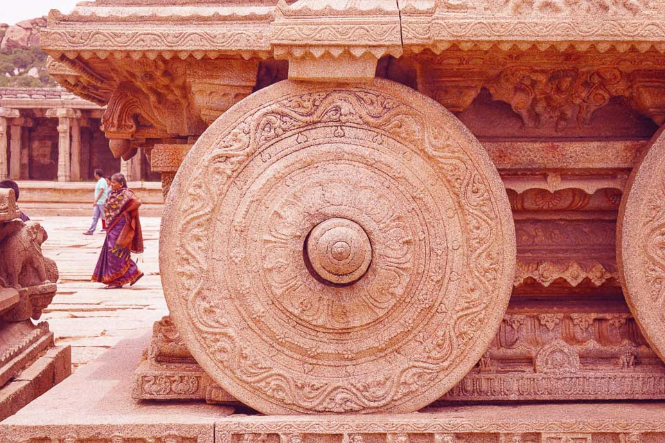 Close up of the wheel at Hampi Chariot: Iconic monuments in India
